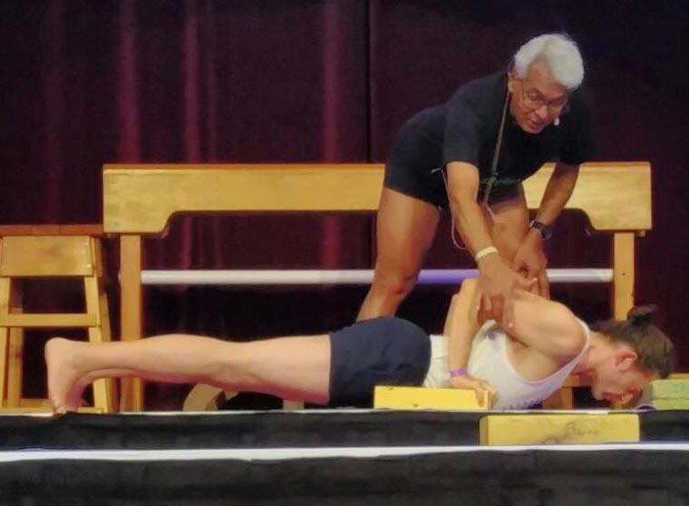 Gav Tilstone being taught Yoga